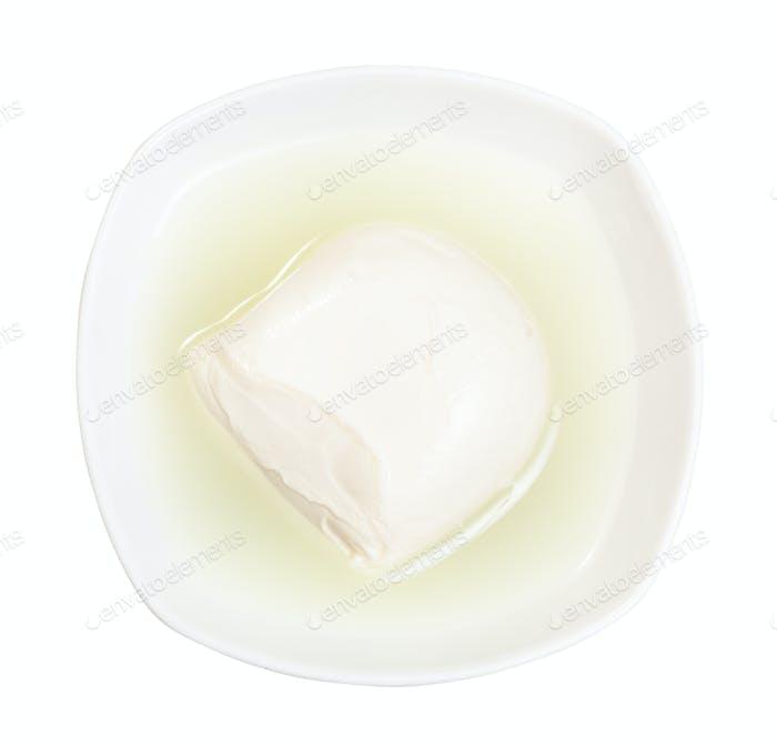fresh mozzarella italian cheese with brine in bowl