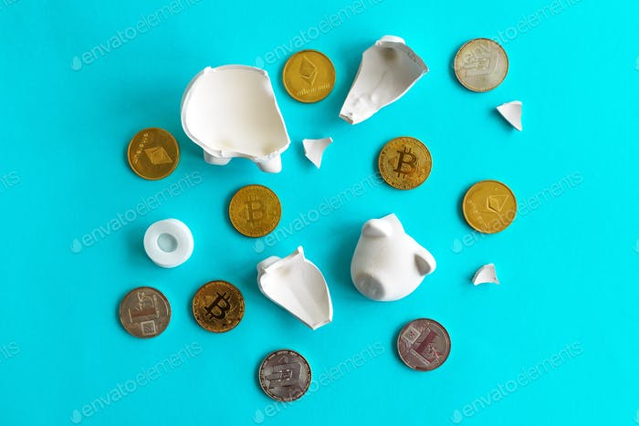 Cryptocurrency coins and broken piggy coin bank