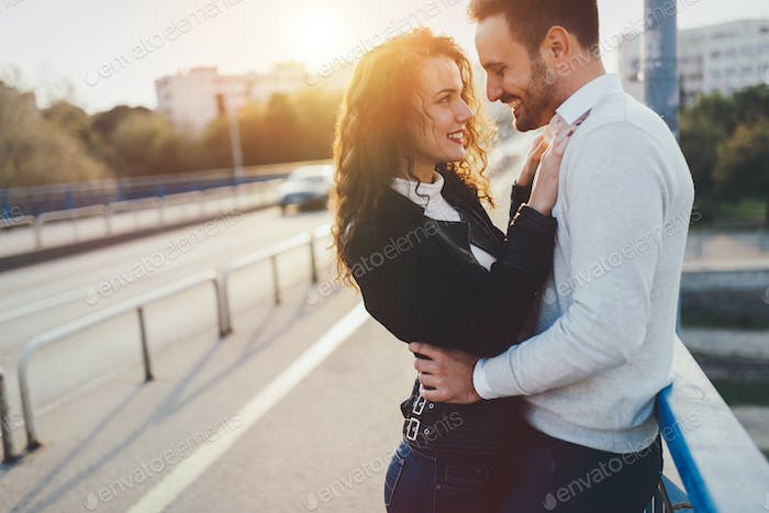 Couple cuddling while enjoying time spent together