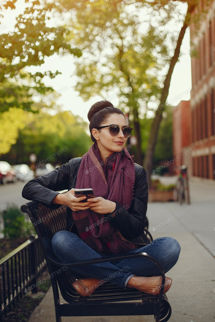 beautiful young girl with phone