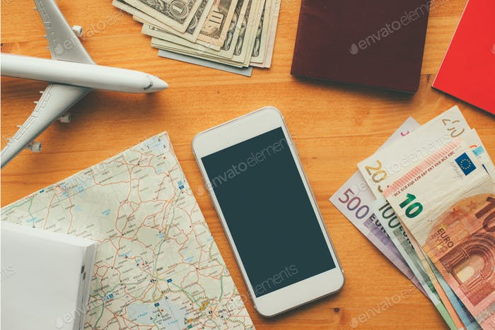 Overhead view of vacation travel concept with smartphone blacnk