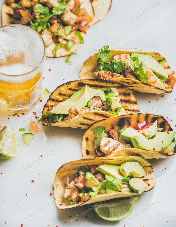 Healthy corn tortillas with grilled chicken fillet, avocado and beer