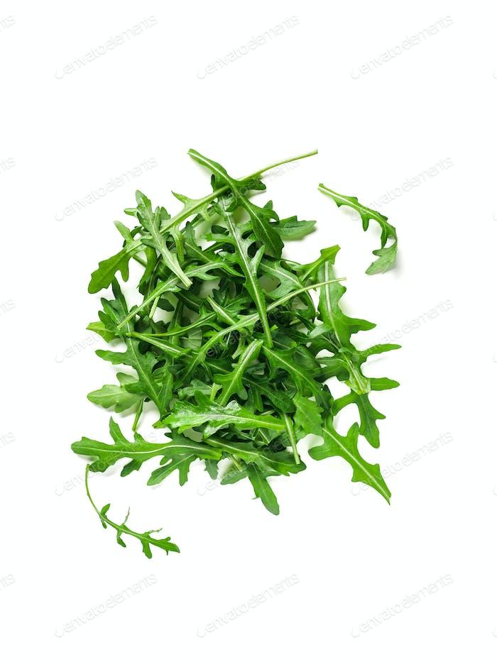 Heap of arugula leaves isolated