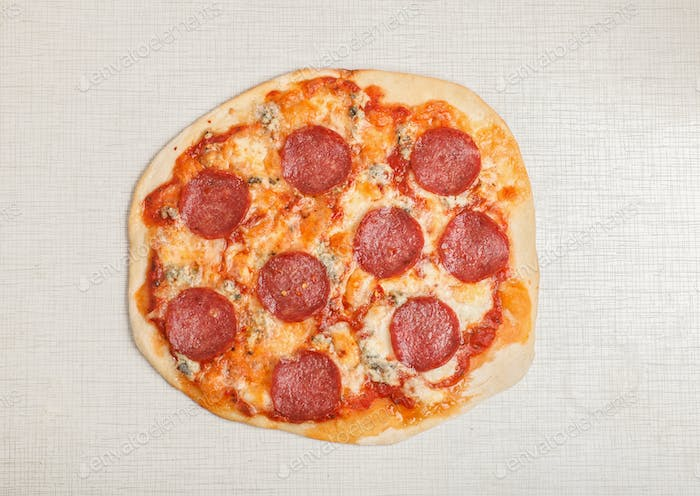 tasty delicious pizza pepperoni on white table, top view