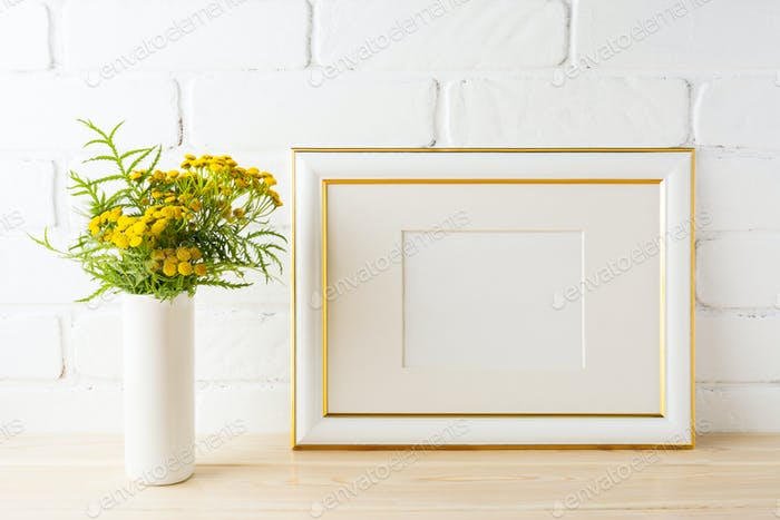 Gold decorated landscape frame mockup near painted brick walls