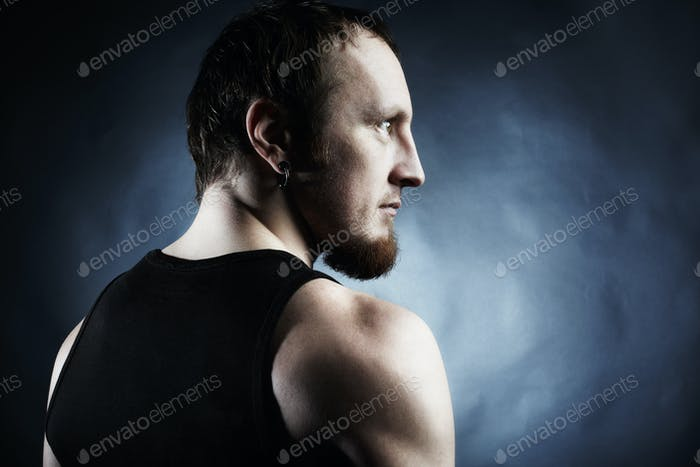 The muscular male back on black background