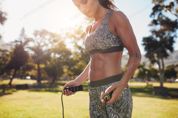 Sportswoman skipping outdoors at the park