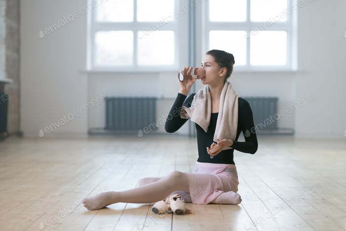 Ballerina drinking water after dance