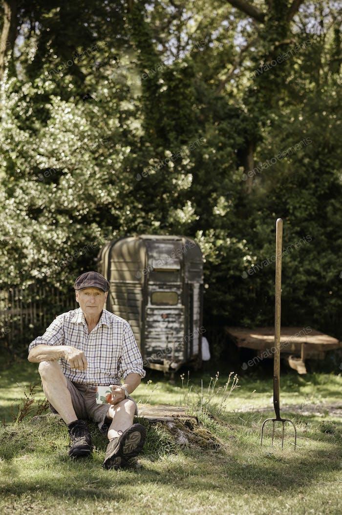 Man sitting in a garden.