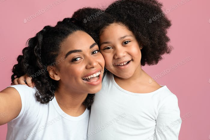 Joyful African American Family Mother And Daughter Posing For Selfie