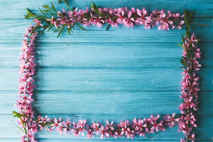 Garden flowers over blue wooden table background