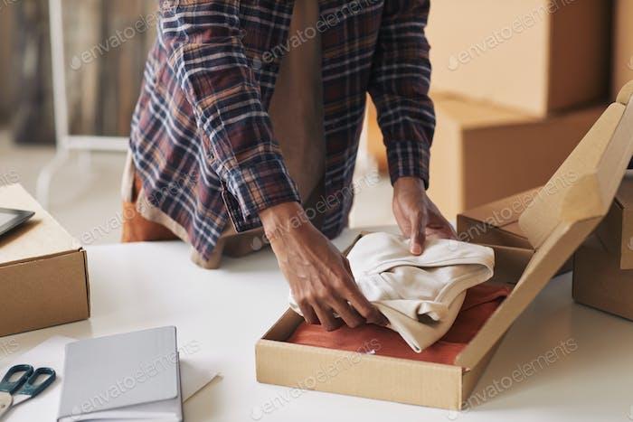 Man packing parcel