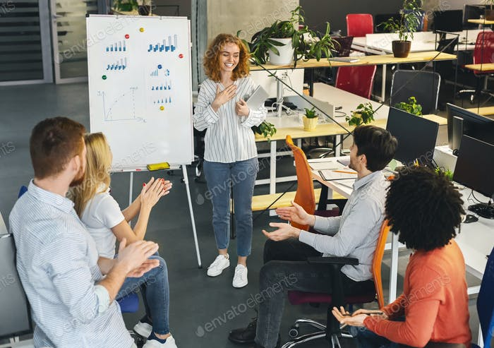 Woman team leader making presentation for colleagues