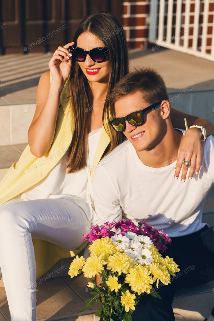 Close up portrait of young stylish cheerful couple in love