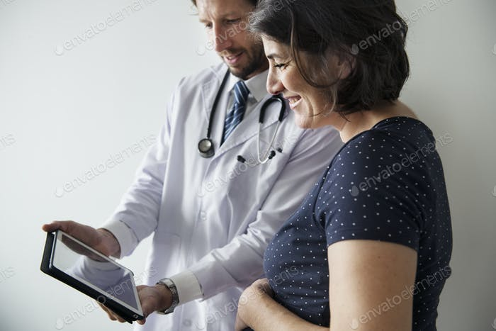 Pregnant woman having fetal monitoring by doctor