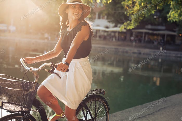 Beautiful young woman riding a bicycle