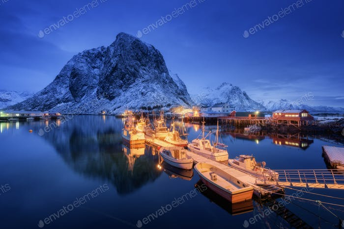 Beautiful fishing village with boats at night, Lofoten islands