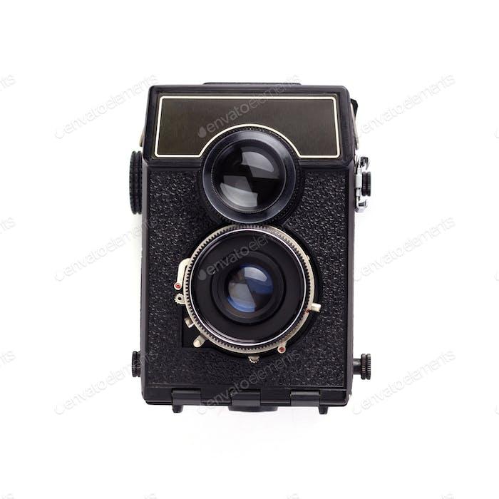 old retro photo film camera on white background
