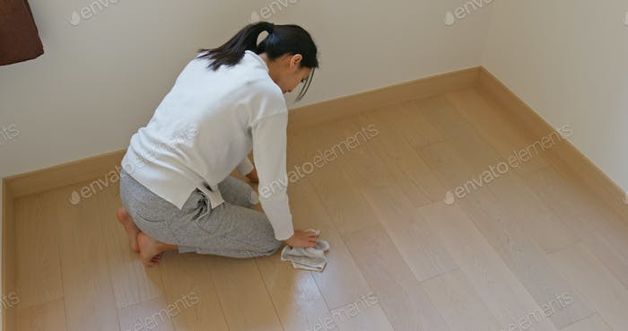 Woman clean the floor for spring clean at home