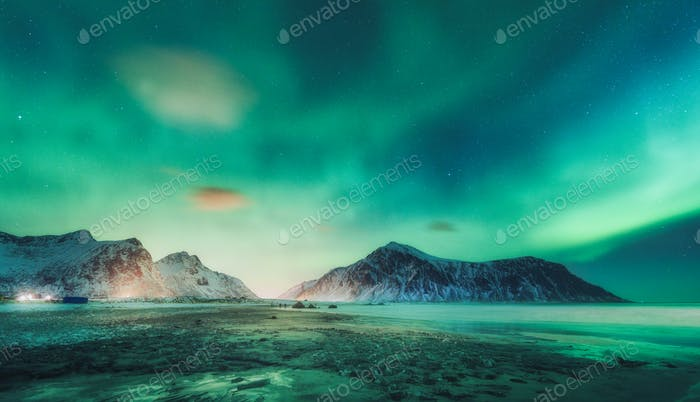 Northern lights above the rocks. Starry sky with polar lights