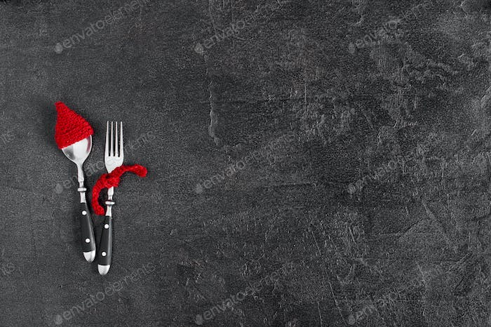 Black Winter Holiday Background with Funny Spoon and Fork