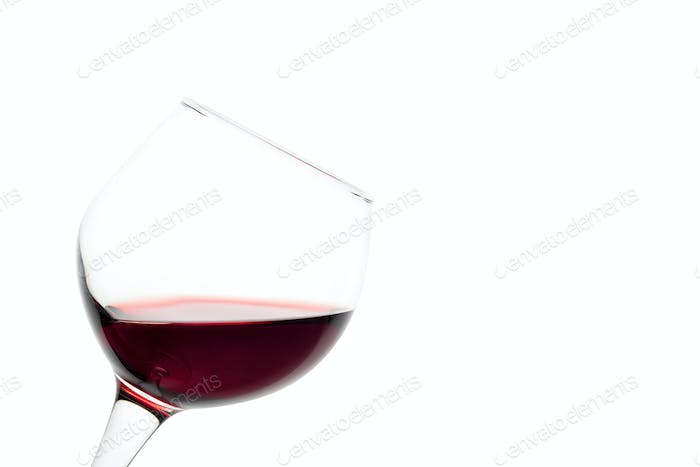 Slanted glass of red wine