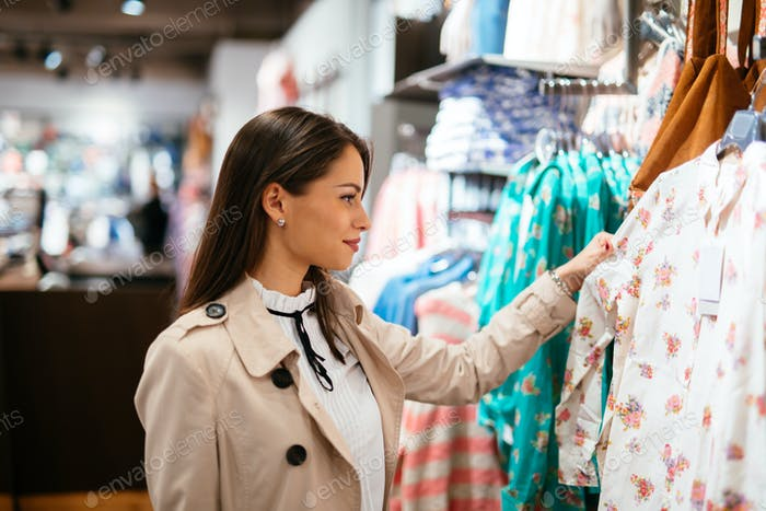 Thumbnail for Beautiful brunette buying clothes