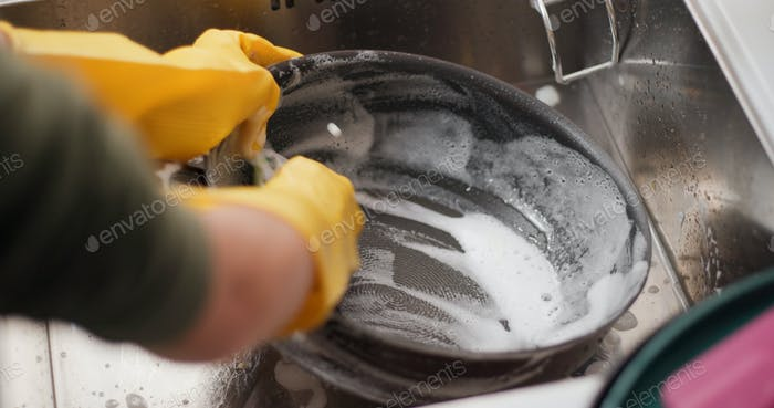 Wash dishes in the kitchen