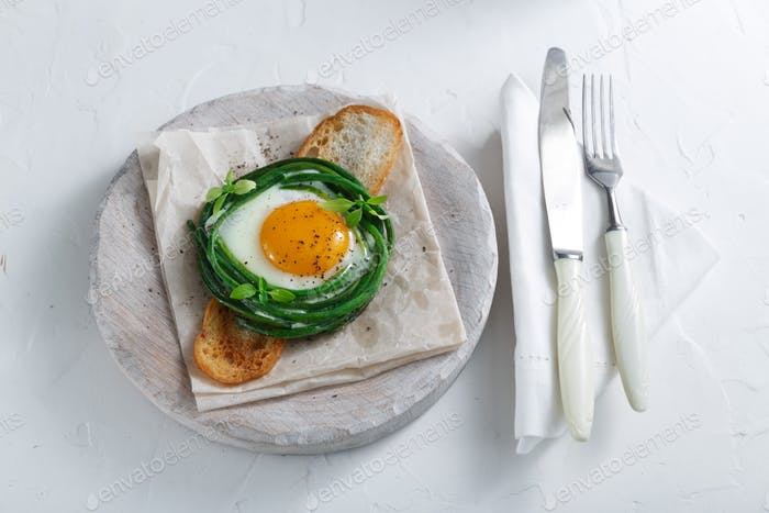 Green beans with sunny side fried egg on toast