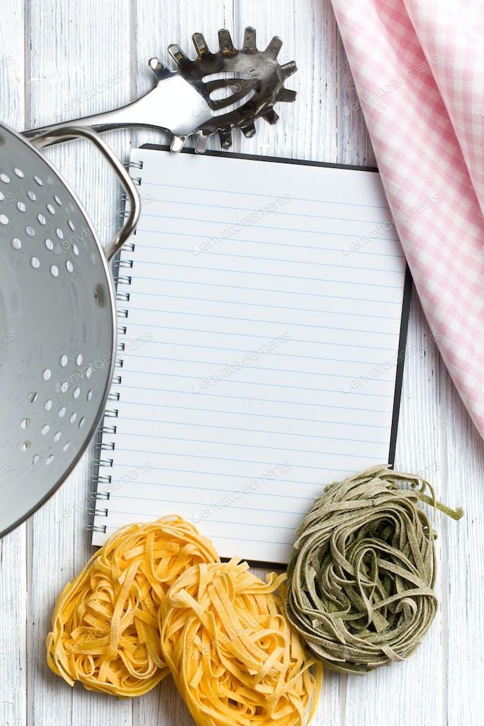 blank recipe book with pasta tagliatelle