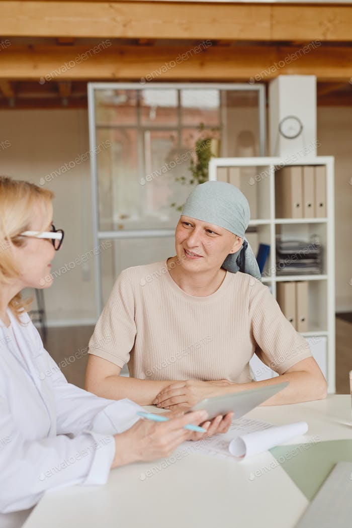 Smiling Female Patient Talking to Doctor