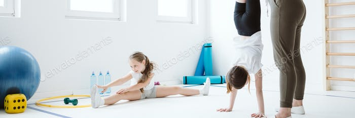 Teenage kids exercising during sport class at school gym
