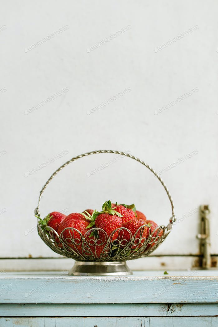 Fresh strawberries in vase