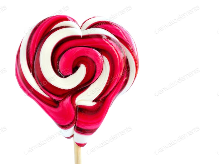 Colourful lollipop in the shape of a heart isolated on white bac