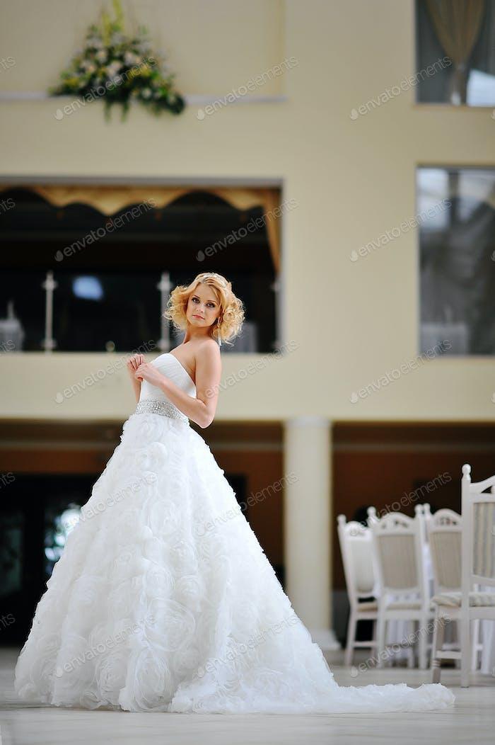 Young beautiful blonde model bride