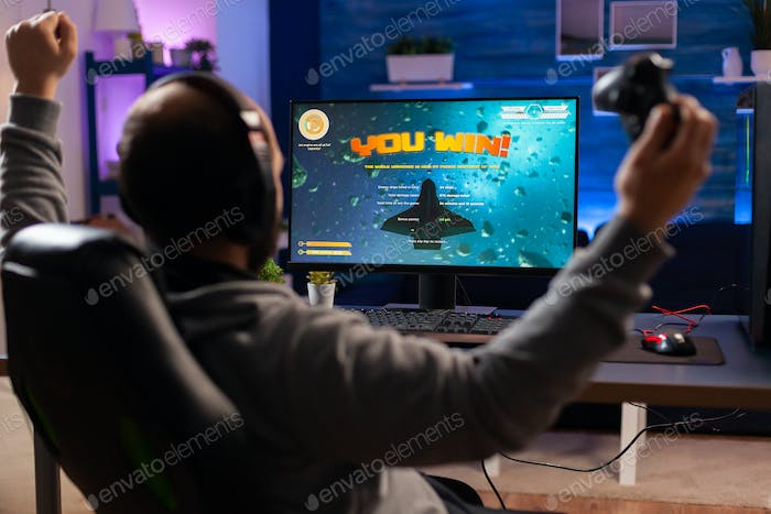 Addicted man playing space shooter videogame