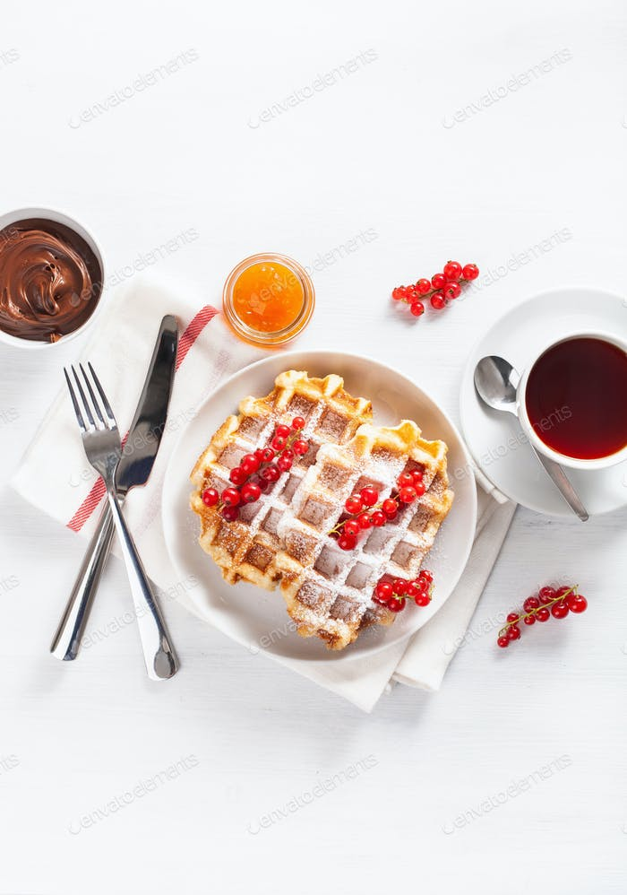breakfast waffle with berry, jam, chocolate spread and tea. Top