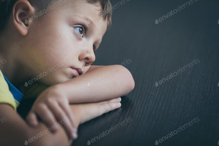 Portrait of one sad little boy.