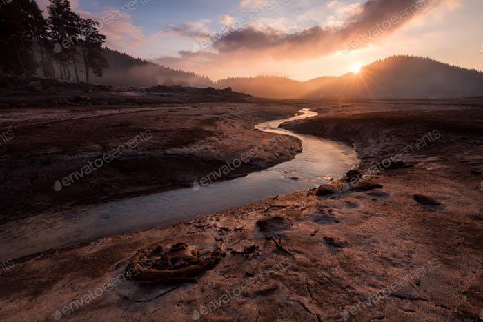 Sunrise over dam Shiroka polyana, Bulgaria, Rhodope mountain, drought