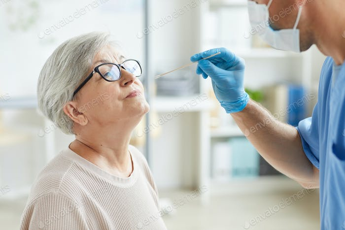 Doctor Testing Woman For Illness