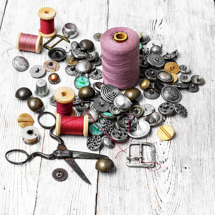large set of threads and buttons