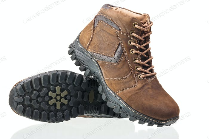 Pair of brown ankle-high men boots isolated over white