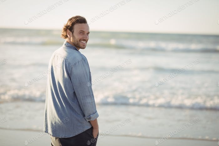 Portrait of smiling young man beach