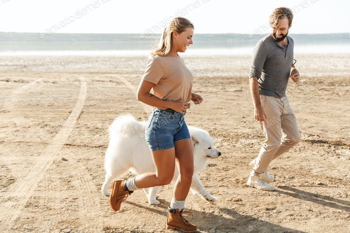 Positive young amazing loving couple with dog