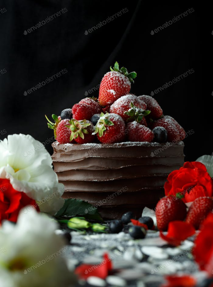 Rpe strawberries in a chocolate cake on a black