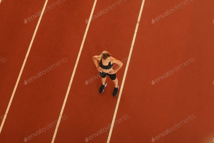 young blonde beautiful sportswoman training on athletic stadium
