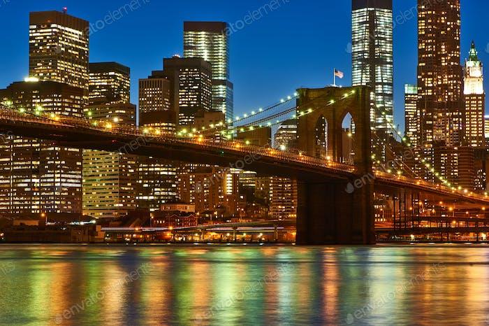 Brooklyn Bridge with lower Manhattan skyline at night