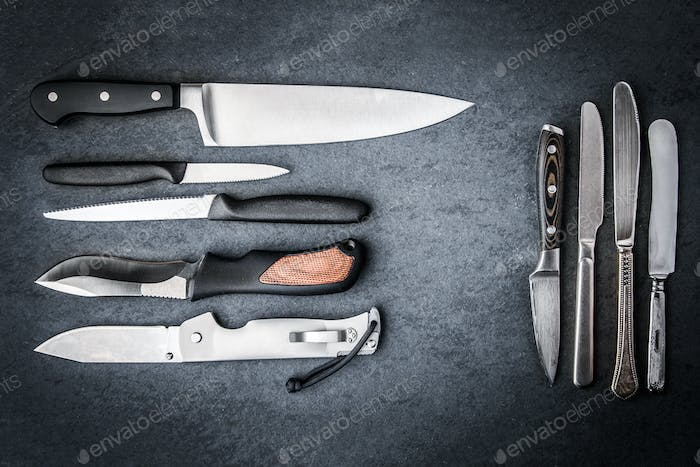 Collection knives on a gray stone