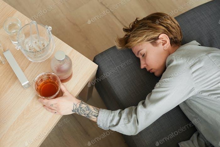 Drunk woman sleeping in the room