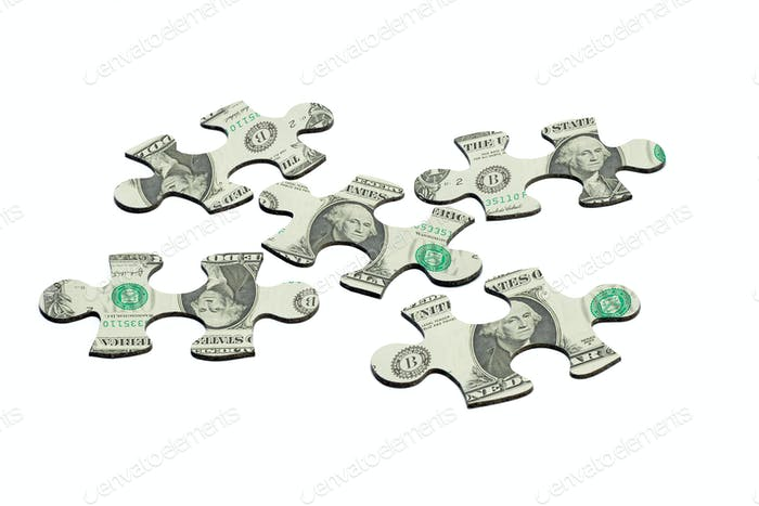 Jigsaw puzzles and US dollar note